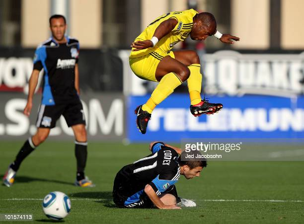 Emilio Renteria of the Columbus Crew leaps over Bobby Convey of the San Jose Earthquakes during an MLS game at Buck Shaw Stadium on June 2 2010 in...