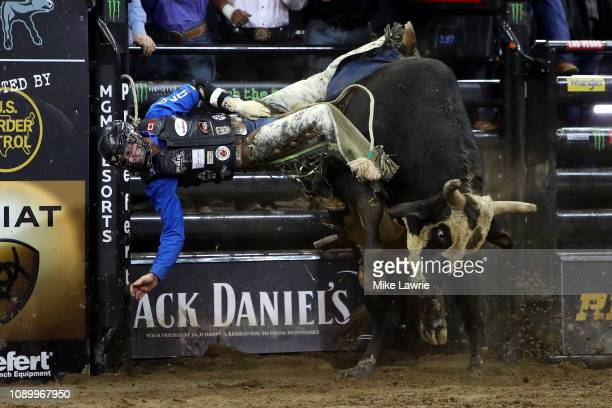 Emilio Resende rides White Out during the PBR Unleash The Beast bull riding event at Madison Square Garden on January 04 2019 in New York City