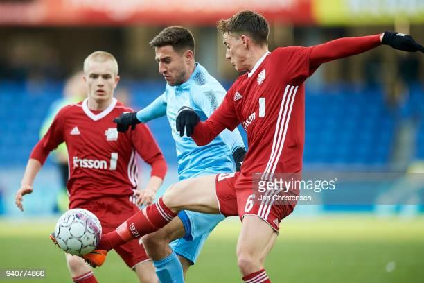 Emilio Simonsen of Lyngby BK Bashkim Kadrii of Randers FC and Mathias Hebo Rasmussen of Lyngby BK compete for the ball during the Danish Alka...