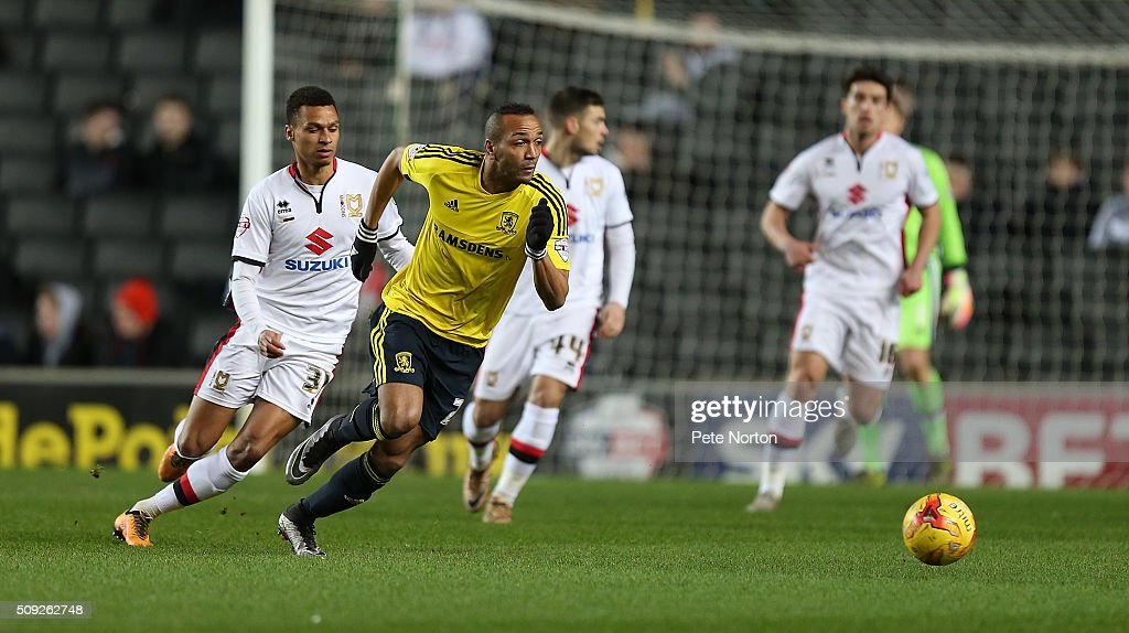 Emillio Nsue of Middlesbrough looks to the ball with Josh Murphy of Milton Keynes Dons during the Sky Bet Championship match between Milton Keynes Dons and Middlesbrough at StadiumMK on February 9, 2016 in Milton Keynes, England.