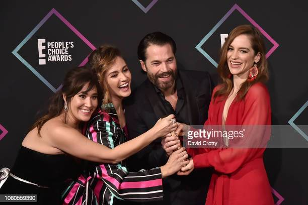 Emily Andras Katherine Barrell Tim Rozon and Melanie Scrofano attend the E People's Choice Awards Press Room at Barker Hangar on November 11 2018 in...