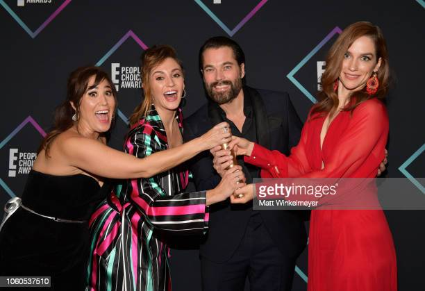 Emily Andras Katherine Barrell Tim Rozon and Melanie Scrofano of Wynonna Earp Scifi/Fantasy Show of 2018 pose in the press room during the People's...