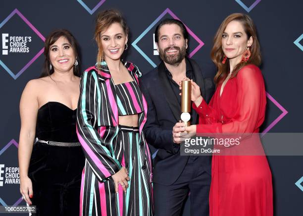 Emily Andras Katherine Barrell Tim Rozon and Melanie Scrofano of Wynonna Earp Scifi/Fantasy Show of 2018 pose in the press room at the People's...
