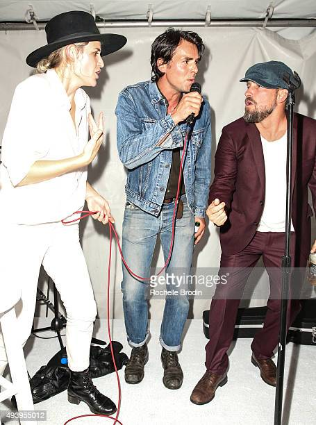 Emily Armstrong Jason Thompson and Brian Bowen Smith sing on stage at 'Metallic Life' by Brian Bowen Smith brought to you by CASAMIGOS Tequila at De...