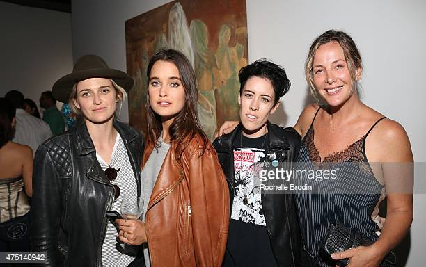 Emily Armstrong Kate Harrison Arden Fisher and Shea Bowen Smith attend the Blue Nudes exhibition at De Re Gallery on May 28 2015 in West Hollywood...