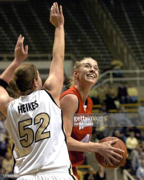 Emily Ashbaugh looks to the basket around the defense of Emily Heikes in the first half of Purdue's 58-42 win