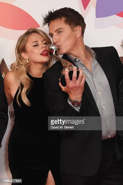 Emily Atack and John Barrowman accepting the Bruce Forsyth Award for Entertainment for I'm A CelebrityGet Me Out Of Here pose in the Winners Room...