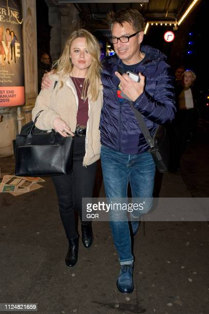 Emily Atack and John Barrowman seen arriving at the Wyndham theatre West End on January 25 2019 in London England