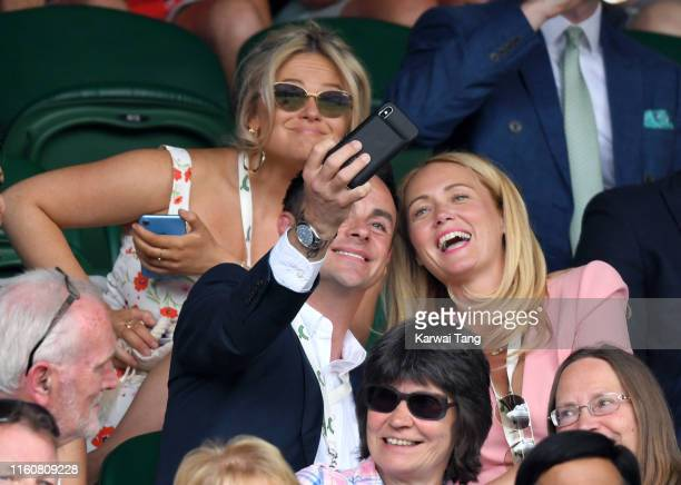 Emily Atack Anthony McPartlin and AnneMarie Corbett attend day seven of the Wimbledon Tennis Championships at All England Lawn Tennis and Croquet...