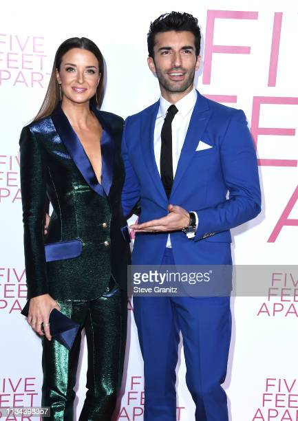 Emily Baldoni and Justin Baldoni arrive at the Premiere of Lionsgate's Five Feet Apart at Fox Bruin Theatre on March 07 2019 in Los Angeles California