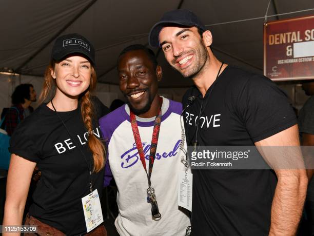 Emily Baldoni guest Willie and Justin Baldoni pose for portrait at the Skid Row Carnival of Love on January 26 2019 in Los Angeles California