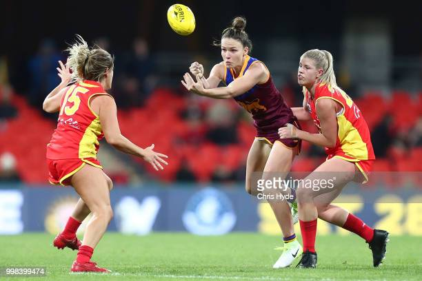 Emily Bates of the Lions handballs during the AFLW Winter Series match between the Gold Coast Suns and the Brisbane Lions at Metricon Stadium on July...