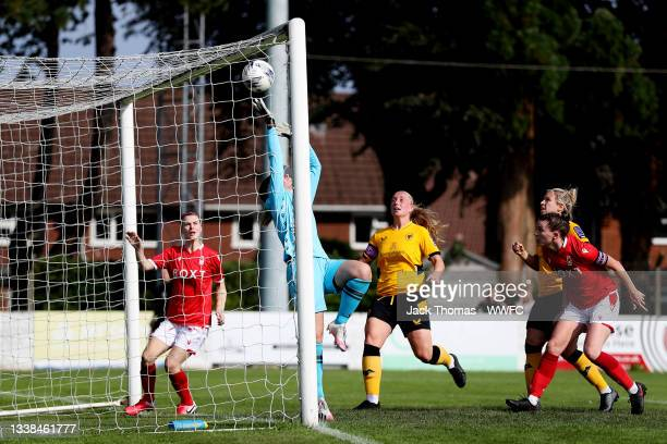 Emily Batty of Nottingham Forest Women attempts to save the shot of Anna Morphet of Wolverhampton Wanderers who scores her team's first goal during...