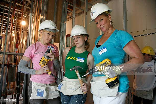 Emily Bergl Anna Chlumsky and Emme help Habitat For Humanity at a building project in Brooklyn on June 28 2011 in New York City