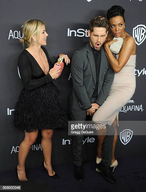 Emily Bett Rickards JeanLuc Bilodeau and Aisha Tyler arrive at the 2016 InStyle And Warner Bros 73rd Annual Golden Globe Awards PostParty at The...
