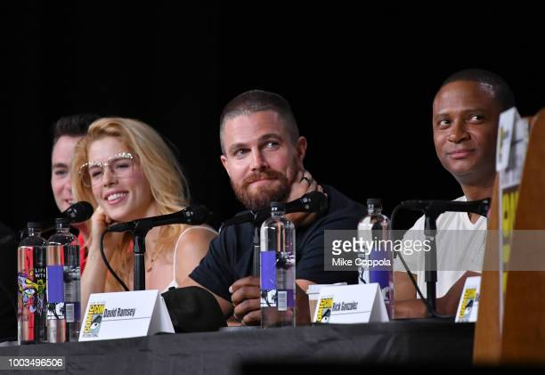 Emily Bett Rickards Stephen Amell and David Ramsey speak onstage at the Arrow Special Video Presentation and QA during ComicCon International 2018 at...