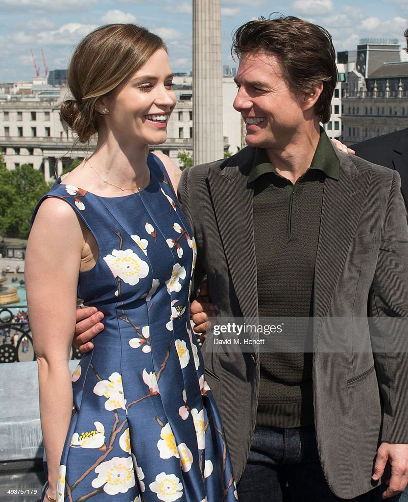 Emily Blunt and Tom Cruise pose at a photocall for