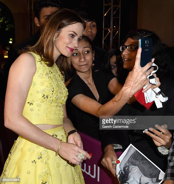 Emily Blunt poses with fans as she attends the Opening Night Gala during day one of the 11th Annual Dubai International Film Festival held at the...
