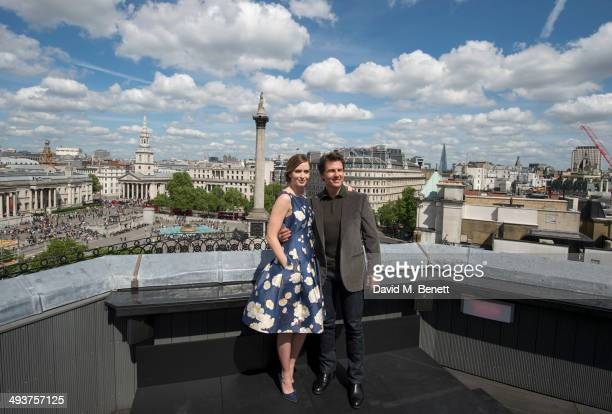 Emily BluntTom CruiseDoug Liman Erwin Stoff pose at a photocall for 'Edge Of Tomorrow' on the rooftop of the Trafalgar Hotel on May 25 2014 in London...