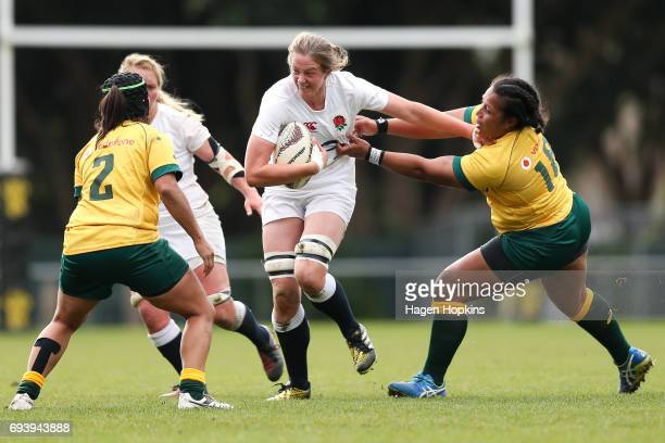 Emily Braund of England fends Hilisha Samoa of Australia during the Women's International Test match between the Australian Wallaroos and the England...