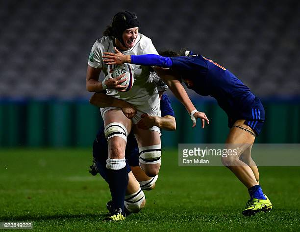 Emily Braund of England is tackled by Manon Andre and Camille Grassineau of France during the Old Mutual Wealth Series match between England Women...