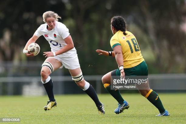 Emily Braund of England looks to evade Hilisha Samoa of Australia during the Women's International Test match between the Australian Wallaroos and...