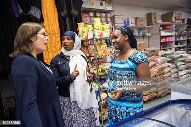 Emily Cain left Democratic candidate for Maine's 2nd Congressional District talks with Somali immigrants including Fatuma Hussein center in Lewiston...