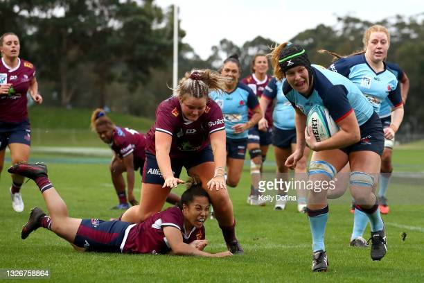 Emily Chancellor of the Waratahs runs with the ball on her way to scoring a try during the Super W Final match between the NSW Waratahs and the...