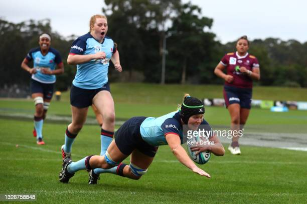Emily Chancellor of the Waratahs scores a try during the Super W Final match between the NSW Waratahs and the Queensland Reds at Coffs Harbour...