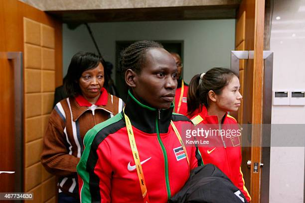 Emily Chebet Muge of Kenya and Changqin Ding of People's Republic of China enters the venue of the press conference of IAAF World Cross Country...