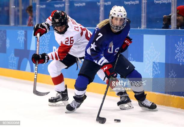 Emily Clark of Canada and Monique LamoureuxMorando of the United States battle for the puck in the first period during the Women's Gold Medal Game on...