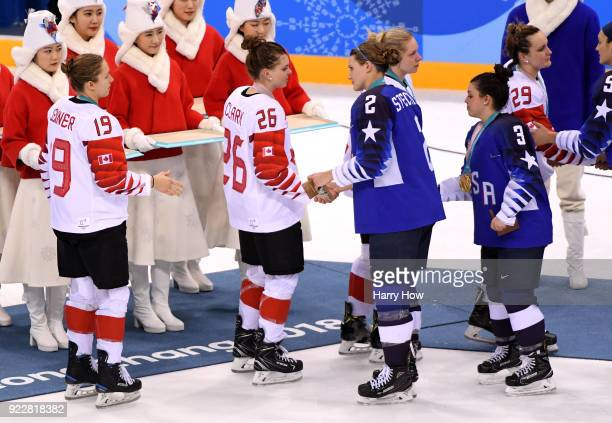 Emily Clark of Canada shakes hands with Lee Stecklein of the United States after the Women's Gold Medal Game on day thirteen of the PyeongChang 2018...