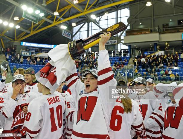 Emily Clark of the Wisconsin Badgers hoists the NCAA Photos via Getty Images championship trophy as they celebrate their 20 win over the Minnesota...