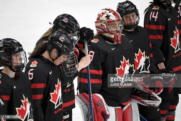 Emily Clark Rebecca Johnston Natalie Spooner Emerance Maschmeyer and AnnSophie Bettez of Canada look dejected after the IIHF Women's Ice Hockey World...