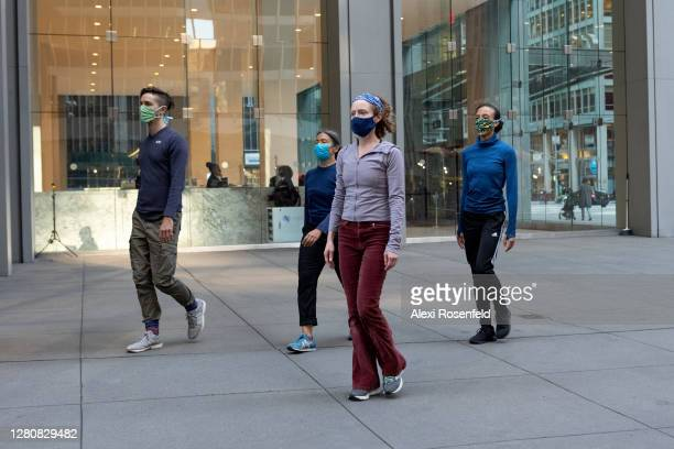 Emily Coates and dancers wearing masks dance outdoors during the Diagonal Redux performance by Yvonne Rainer on October 17, 2020 in New York City....