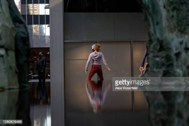 Emily Coates wearing a mask dances outdoors during the Diagonal Redux performance by Yvonne Rainer on October 17, 2020 in New York City. Diagonal...
