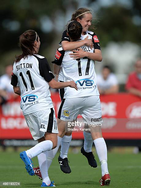 Emily Condon of Adelaide celebrates scoring a goal with her team mates during the round three WLeague match between Brisbane Roar and Adelaide United...