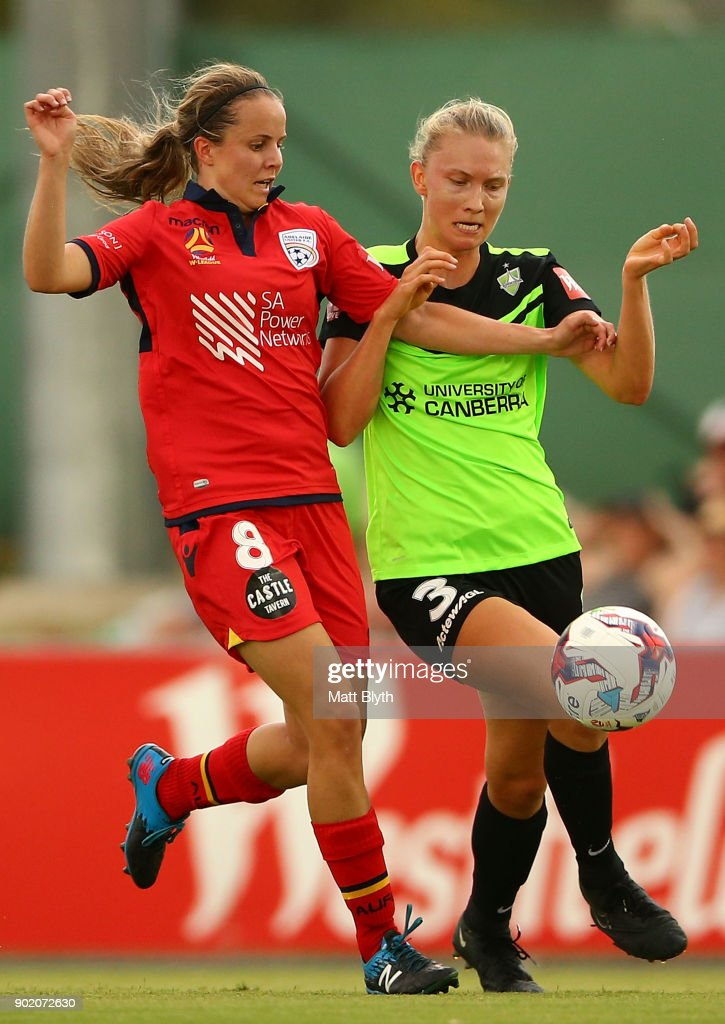 Emily Condon of Adelaide United and Clare Hunt of Canberra United FC compete for the ball during the round 10 W-League match between Canberra United and Adelaide United at McKellar Park on January 7, 2018 in Canberra, Australia.