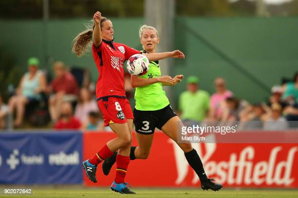 Emily Condon of Adelaide United and Clare Hunt of Canberra United FC compete for the ball during the round 10 WLeague match between Canberra United...
