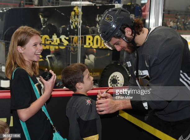 Emily Costello and her brother Ethan Costello both of Nevada get autographs from Colin Miller of the Vegas Golden Knights during the team's first...