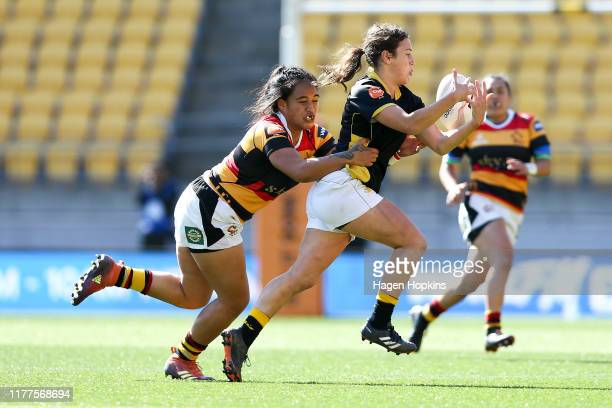 Emily Dalley of Wellington is tackled by Lonita NgaluLavemai of Waikato during the round 5 Farah Palmer Cup match between Wellington and Waikato at...