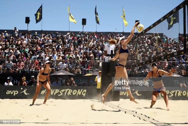Emily Day goes up to spike the ball as her partner Betsi Flint looks on during their semifinal match against Brittany Howard and Kelly Reeves of the...