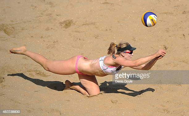 Emily Day of the US returns the ball during her Transavia Grand Slam beach volleyball main draw match against Italy's Martha Menegatti and Viktoria...