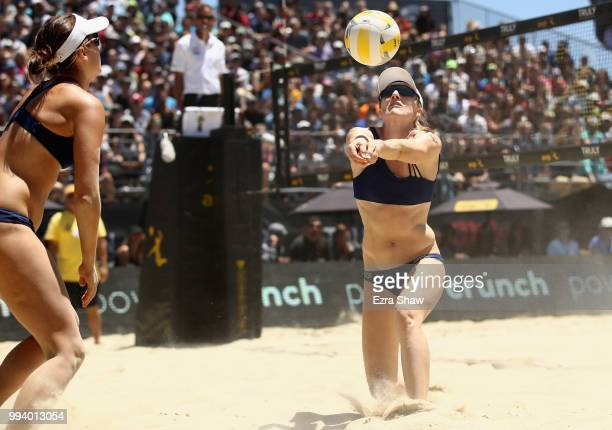 Emily Day sets the ball for Betsi Flint during their semifinal match against Brittany Howard and Kelly Reeves of the AVP San Francisco Open at Pier...