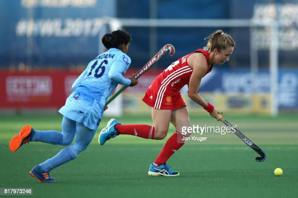 Emily Defroand of England attempts to get away from Renuka Yadav of India during the Quarter Final match between England and India during the FIH...