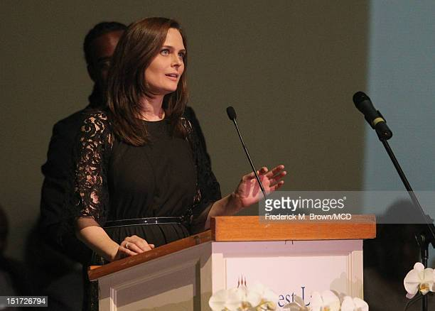 Emily Deschanel speaks onstage at Michael Clarke Duncan's Memorial Service at Forest Lawn Cemetery on September 10 2012 in Los Angeles California
