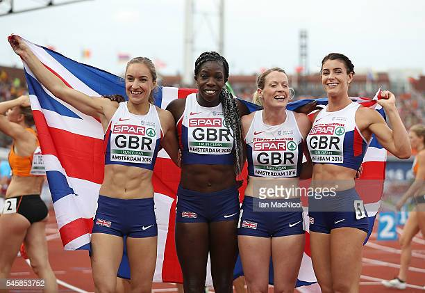 Emily Diamond Anyika Onuora Eilidh Doyle and Serena Bundy Davies of Great Britan celebrate winning gold in the final of the womens 4x400m relay on...