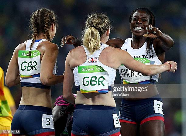 Emily Diamond Eilidh Doyle and Christine Ohuruogu of Great Britain react after winning bronze in the Women's 4 x 400 meter Relay on Day 15 of the Rio...