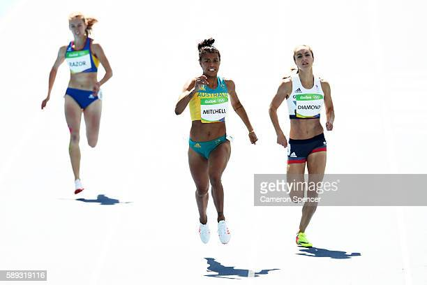 Emily Diamond of Great Britain and Morgan Mitchell of Australia compete in round one of the Women's 400m on Day 8 of the Rio 2016 Olympic Games at...
