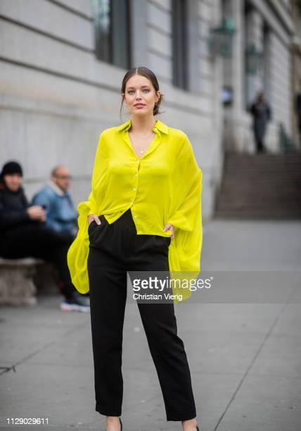 Emily DiDonato is seen wearing yellow blouse black pants outside Carolina Herrera during New York Fashion Week Autumn Winter 2019 on February 11 2019...